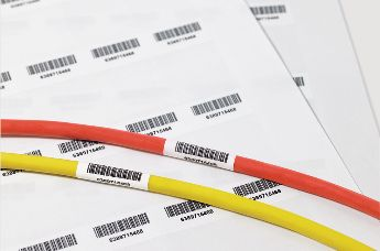 Self-laminating labels for cable marking