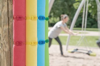 Not only because of their variety of colours, cable ties with low profile head are often used on children's playgrounds.