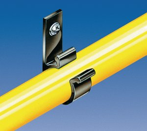 The clip is held in place by a screw and the bundled cable or pipe is guided securely.