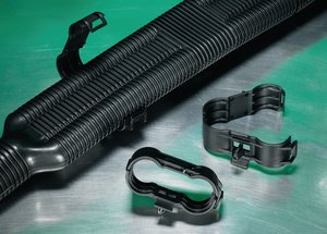 Simple and secure installation of pipes or hoses to panels.