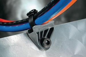 Axial oval mounts stand off bundles from frame rails and cross members to prevent them from rubbing and chafing.
